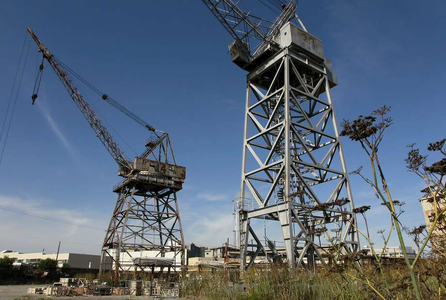 Rusty cranes tower above an area called Crane Cove at Pier 70 on S.F.'s central waterfront, which will become an 8-acre park. Photo: Paul Chinn, The Chronicle