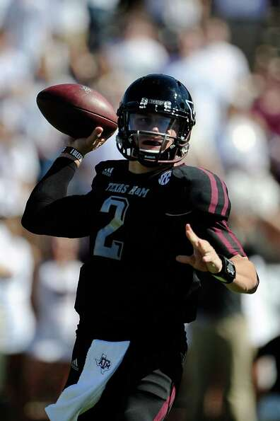 Johnny Manziel #2 of the Texas A&M Aggies drops back to pass against the Mississippi State Bulldogs.