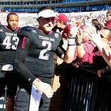Johnny Manziel #2 of the Texas A&M Aggies greets fans following a victory over the Mississippi State Bulldogs at Wade Davis Stadium on November 3, 2012 in Starkville, Mississippi. (Stacy Revere / Getty Images)