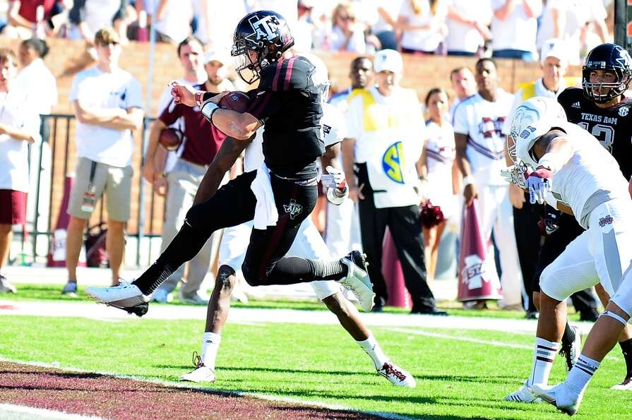 Johnny Manziel #2 of the Texas A&M Aggies leaps into the endzone during a game against the Mississip