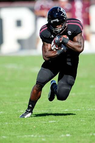 Christine Michael #33 of the Texas A&M Aggies runs for yards against the Mississippi State Bulldogs at Wade Davis Stadium on November 3, 2012 in Starkville, Mississippi.   (Stacy Revere / Getty Images)