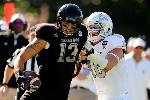 Mike Evans #13 of the Texas A&M Aggies avoids a tackle by Cameron Lawrence #10 of the Mississippi State Bulldogs at Wade Davis Stadium on November 3, 2012 in Starkville, Mississippi.  (Stacy Revere / Getty Images)