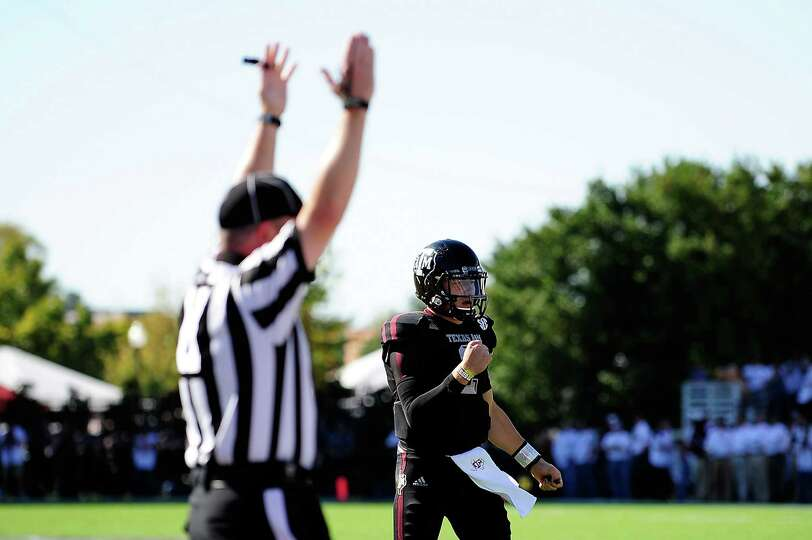 Johnny Manziel #2 of the Texas A&M Aggies reacts to a touchdown against the Mississippi State Bulldo