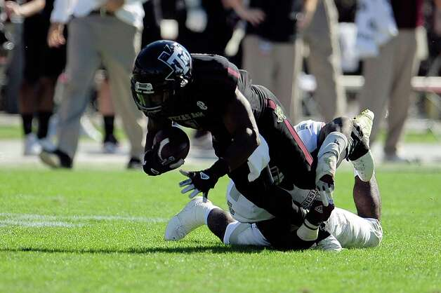 Ben Malena #1 of the Texas A&M Aggies is brought down by Nikoe Whitley #5 of the Mississippi State Bulldogs. Photo: Stacy Revere, Getty Images / 2012 Getty Images