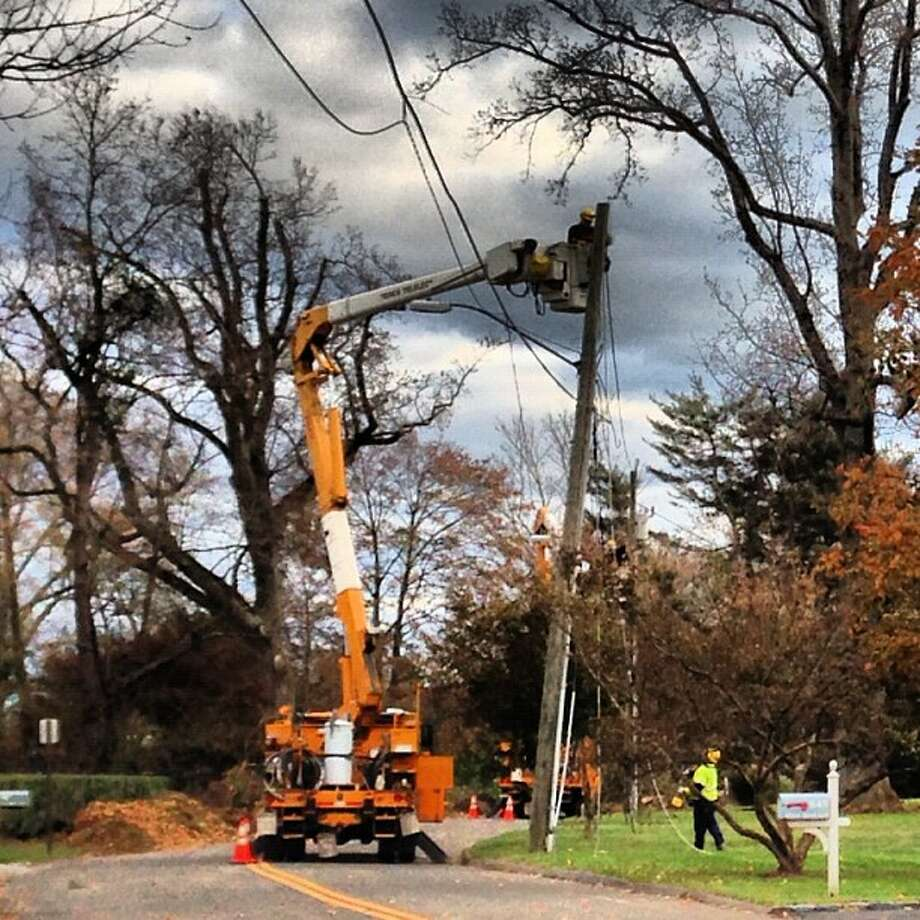 The Indiana crew is working in front of Gov. Malloy's old house in Stamford.  (Photo by Kara Billhardt) Photo: Contributed Photo / Connecticut Post Contributed