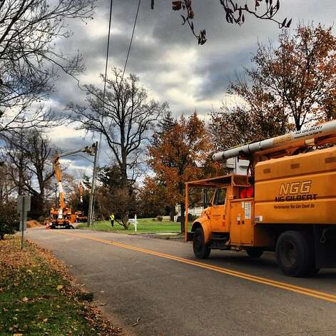 A crew from Indiana works on trees and lines simultaneously in Stamford Saturday.  (Photo by Kara Billhardt) Photo: Contributed Photo / Connecticut Post Contributed