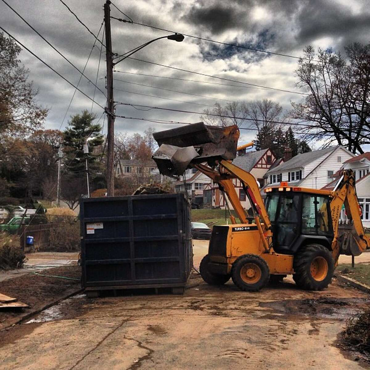 Clean-up continues Saturday. There goes an oven. What a mess. (Photo by Kara Billhardt)