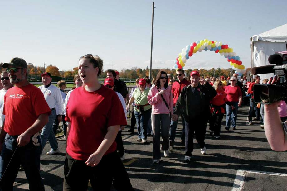 Peter Bardunias and his wife Eileen (at right under the balloons; she is wearing pink, and he has a red hat) at the North Country Heart Walk on Oct. 20 in Saratoga County.  Courtesy American Heart Association