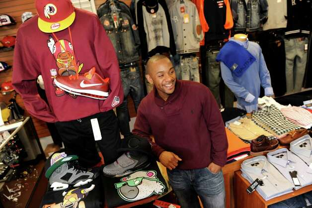 Shop owner Angelo Maddox on Wednesday, Oct. 24, 2012, at Fresh Fly in Albany, N.Y. The recently opened store offers sportswear, business casual and fun clothes and accessories for men and women. Maddox said he considers himself an image consultant who can enhance his customers' swagger. (Cindy Schultz / Times Union) Photo: Cindy Schultz / 00019806A