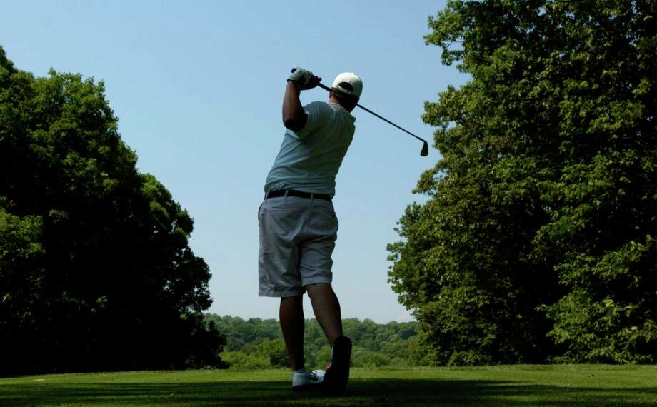 Mike Ballo, of Trinity Catholic High School tees off during the Brian Fitzpatrick Memorial Golf Tournament at Woodway Country Club. Photo: Staff File Photo