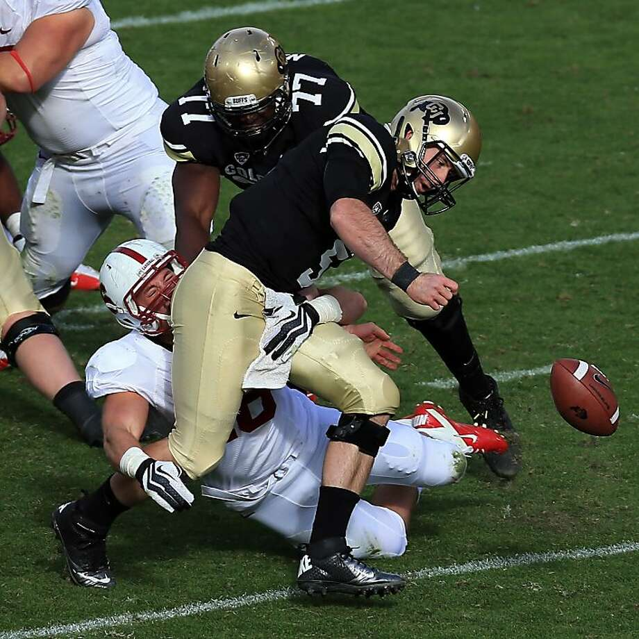 Linebacker Kevin Anderson forces a fumble by Colorado quarterback Connor Wood, one of three turnovers for the Buffaloes. Photo: Doug Pensinger, Getty Images