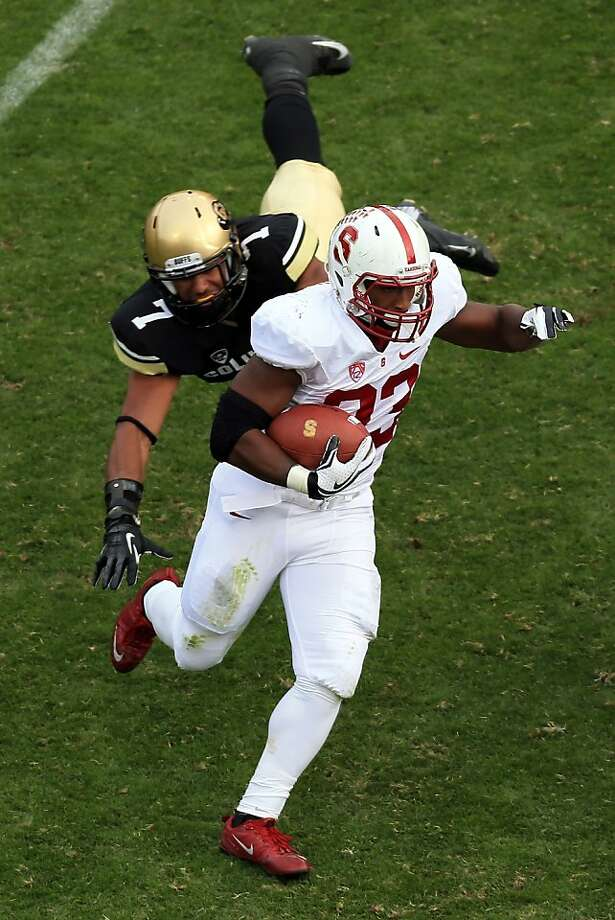 BOULDER, CO - NOVEMBER 03:  Running back Stepfan Taylor #33 of the Stanford Cardinals picks up yardage as he eludes defensive back Ray Polk #7 of the Colorado Buffaloes at Folsom Field on November 3, 2012 in Boulder, Colorado.  (Photo by Doug Pensinger/Getty Images) Photo: Doug Pensinger, Getty Images
