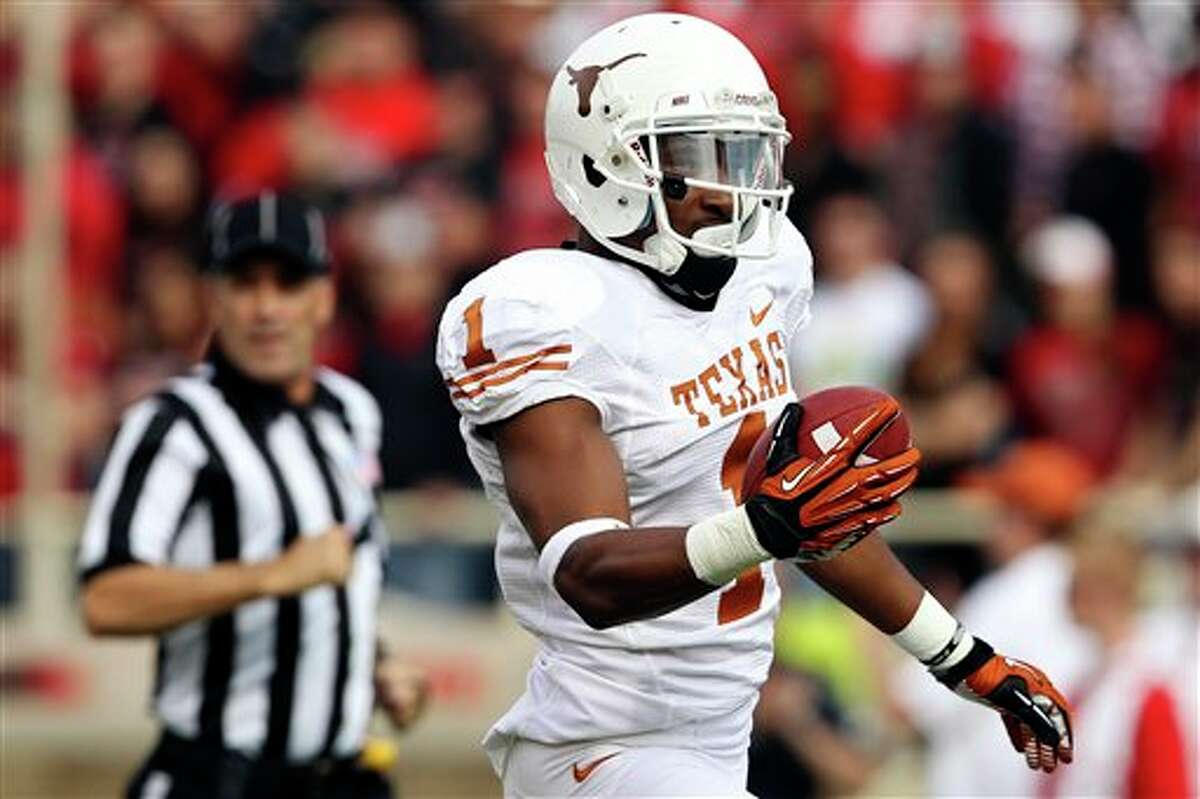 Texas' Mike Davis scores a touchdown against Texas Tech during their NCAA college football game, Saturday, Nov. 3, 2012, in Lubbock, Texas. (AP Photo/Lubbock Avalanche-Journal,Stephen Spillman) LOCAL TV OUT