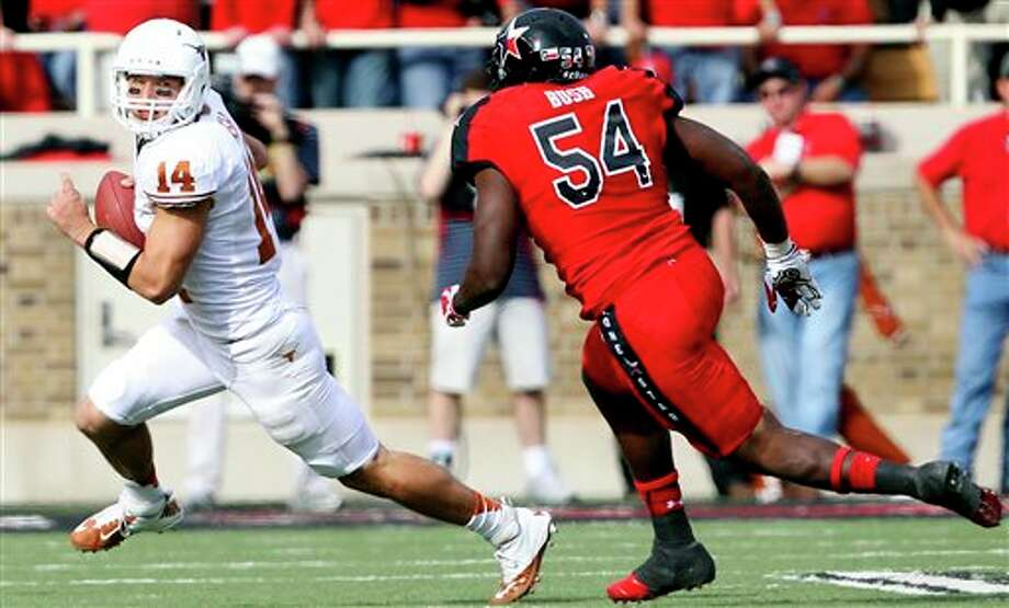 Texas' David Ash runs from Texas Tech's Dartwan Bush during their NCAA college football game, Saturday, Nov. 3, 2012, in Lubbock, Texas. (AP Photo/Lubbock Avalanche-Journal,Stephen Spillman)  LOCAL TV OUT Photo: Stephen Spillman, AP / The Avalanche-Journal