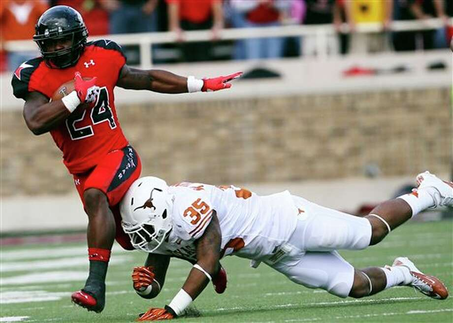 Texas Tech's Eric Stephens is hit by Texas' Kendall Thompson during their NCAA college football game, Saturday, Nov. 3, 2012, in Lubbock, Texas. (AP Photo/Lubbock Avalanche-Journal,Stephen Spillman)  LOCAL TV OUT Photo: Stephen Spillman, AP / The Avalanche-Journal