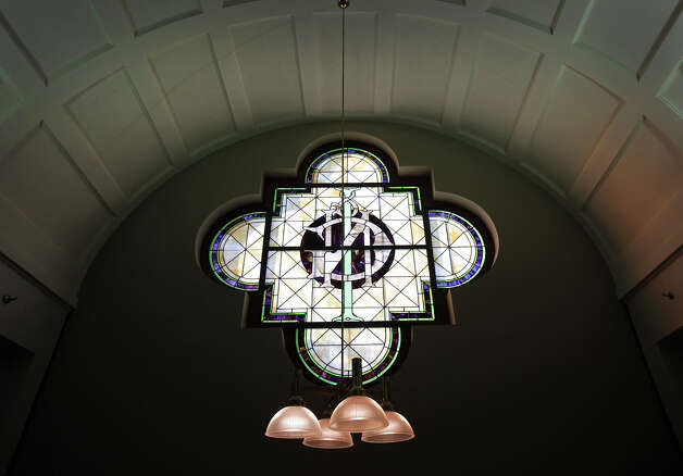 Lights hang from the ceiling near the IGN stained glass window.  The Generations Federal Credit Union has closed it's doors on its west side branch inside the old International and Great Northern Railroad Station.  Via Metropolitan Transit has purchased the location to build the first phase of it's West Side Multimodal Center which is to open Dec. 17.  Wednesday, Oct. 31, 2012. Photo: Bob Owen, San Antonio Express-News / © 2012 San Antonio Express-News