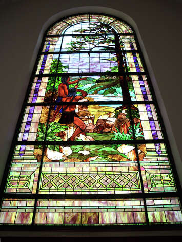 "The stained glass titled ""Two Indians at the River"" is just one of the highlights of the old International and Great Northern Depot. The Generations Federal Credit Union has closed it's doors on its west side branch inside the old International and Great Northern Railroad Station.  Via Metropolitan Transit has purchased the location to build the first phase of it's West Side Multimodal Center which is to open Dec. 17.  Wednesday, Oct. 31, 2012. Photo: Bob Owen, San Antonio Express-News / © 2012 San Antonio Express-News"