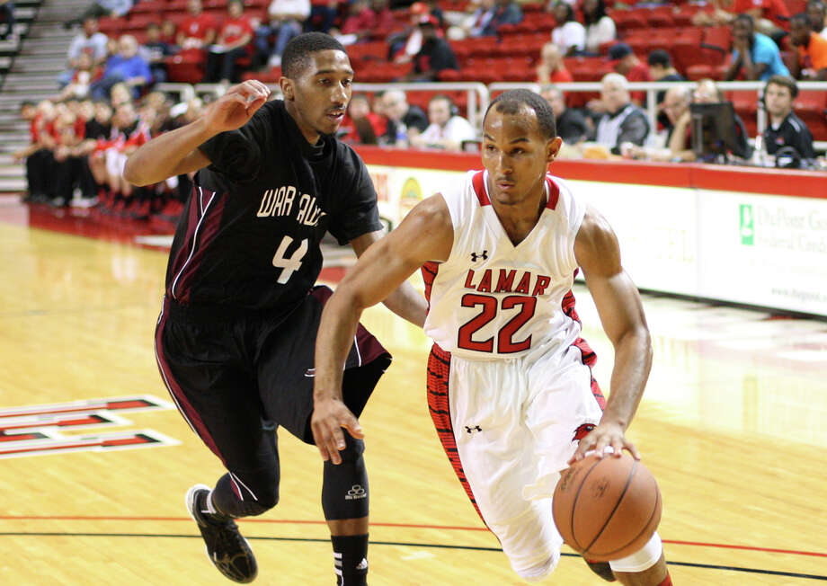 Lamar's Donley Minor, No. 22, drives past McMurry's Takoby Jackson during the game Saturday in the Montagne Center. (Matt Billiot/Special to the Enterprise)
