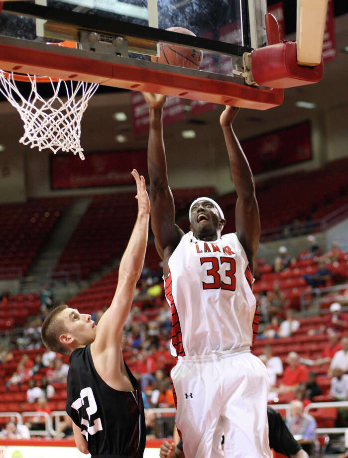 Osas Ebomwonyi, No. 33, hits a shot against McMurry during the game Saturday in the Montagne Center. (Matt Billiot/Special to the Enterprise)