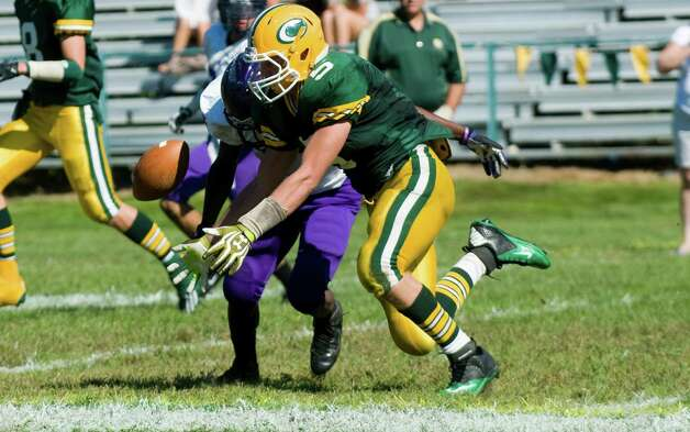 Trinity Catholic's Cody Zaro breaks up a pass intended for Westhill's Jeff Glover earlier this season. Photo: Keelin Daly / Stamford Advocate Freelance