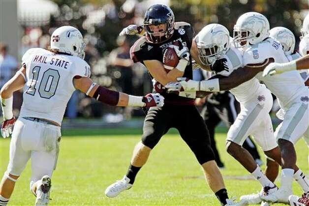 Texas A&M wide receiver Ryan Swope (25) is pressured by Mississippi State players including Cameron Lawrence (10) and Nickoe Whitley following a short pass reception in the second quarter of their NCAA college football game in Starkville, Miss., Saturday, Nov. 3, 2012.  (Rogelio V. Solis / Associated Press) Photo: Rogelio V. Solis, AP / AP