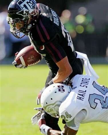 Texas A&M wide receiver Sabian Holmes (23) is tackled by Mississippi State defensive back Jamerson Love (24) after catching a pass in the first quarter of their NCAA college football game in Starkville, Miss., Saturday, Nov. 3, 2012. Texas A&M won 38-13. (Rogelio V. Solis / Associated Press) Photo: Rogelio V. Solis, AP / AP