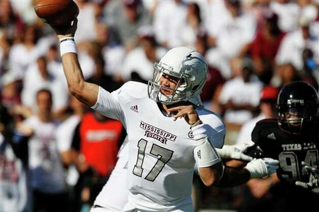 Mississippi State quarterback Tyler Russell (17) throws a pass while Texas A&M defensive lineman Damontre Moore (94) is blocked in the first quarter of their NCAA college football game in Starkville, Miss., Saturday, Nov.  (Rogelio V. Solis / Associated Press) Photo: Rogelio V. Solis, AP / AP