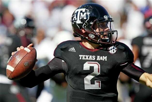 Texas A&M quarterback Johnny Manziel (2) looks for an open receiver during the first quarter of an NCAA college football game against Mississippi State in Starkville, Miss., Saturday, Nov. 3, 2012.  Texas A&M won 38-13.  (Rogelio V. Solis / Associated Press) Photo: Rogelio V. Solis, AP / AP