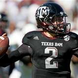 Texas A&M quarterback Johnny Manziel (2) looks for an open receiver during the first quarter of an NCAA college football game against Mississippi State in Starkville, Miss., Saturday, Nov. 3, 2012.  Texas A&M won 38-13.  (Rogelio V. Solis / Associated Press)