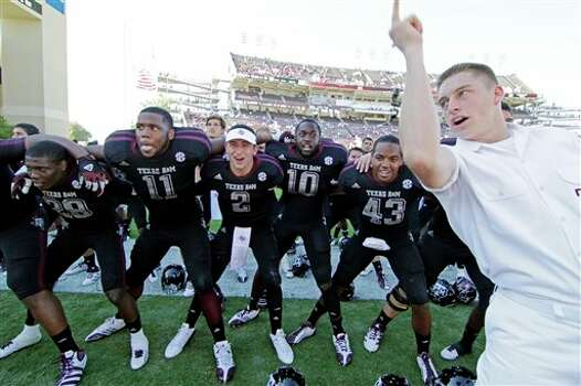 Texas A&M quarterback Johnny Manziel (2) joins teammates as they sing the school chant with a yell leader after their 38-13 win against Mississippi State in their NCAA college football game in Starkville, Miss., Saturday, Nov. 3, 2012.  (Rogelio V. Solis / Associated Press) Photo: Rogelio V. Solis, AP / AP