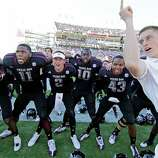 Texas A&M quarterback Johnny Manziel (2) joins teammates as they sing the school chant with a yell leader after their 38-13 win against Mississippi State in their NCAA college football game in Starkville, Miss., Saturday, Nov. 3, 2012.  (Rogelio V. Solis / Associated Press)