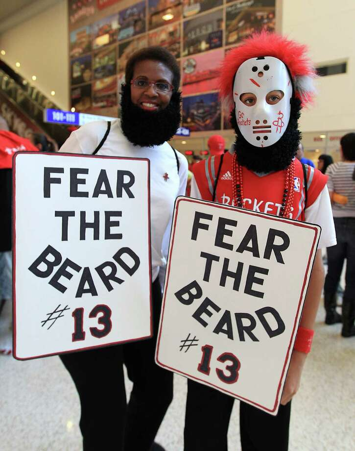 "Madeline Bresalier and her son, Benjamin, 13, wear beards and carry signs that read ""Fear the Beard #13"" before the start of the home opener NBA game at Toyota Center, Saturday, Nov. 3, 2012, in Houston. Photo: Karen Warren, Houston Chronicle / © 2012  Houston Chronicle"