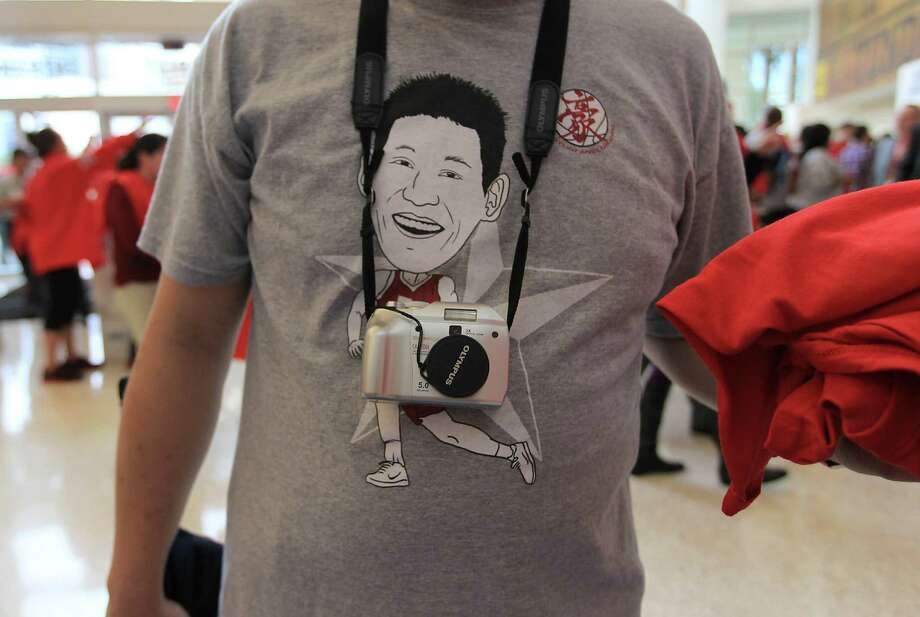 Chan Gu wears a Jeremy Lin t-shirt in the lobby before the start of the home opener NBA game at Toyota Center, Saturday, Nov. 3, 2012, in Houston. Photo: Karen Warren, Houston Chronicle / © 2012  Houston Chronicle
