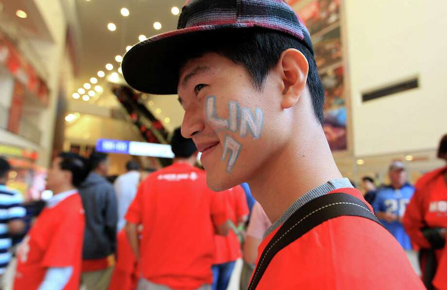 A Jeremy Lin fan in the lobby before the start of the home opener NBA game at Toyota Center, Saturday, Nov. 3, 2012, in Houston. Photo: Karen Warren, Houston Chronicle / © 2012  Houston Chronicle