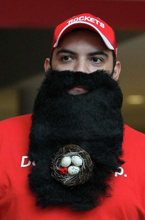 "Matt Martinez wears ""the beard"" with a birds nest tacked onto it before the start of the home opener NBA game at Toyota Center, Saturday, Nov. 3, 2012, in Houston. Photo: Karen Warren, Houston Chronicle / © 2012  Houston Chronicle"