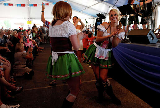 Cheyenne Hodges, right, Shannon Sheffield, left, both of Austin, dance as the Alex Meixner Band plays during Wurstfest in New Braunfels on Saturday, Nov. 3, 2012. Photo: Lisa Krantz, San Antonio Express-News / © 2012 San Antonio Express-News