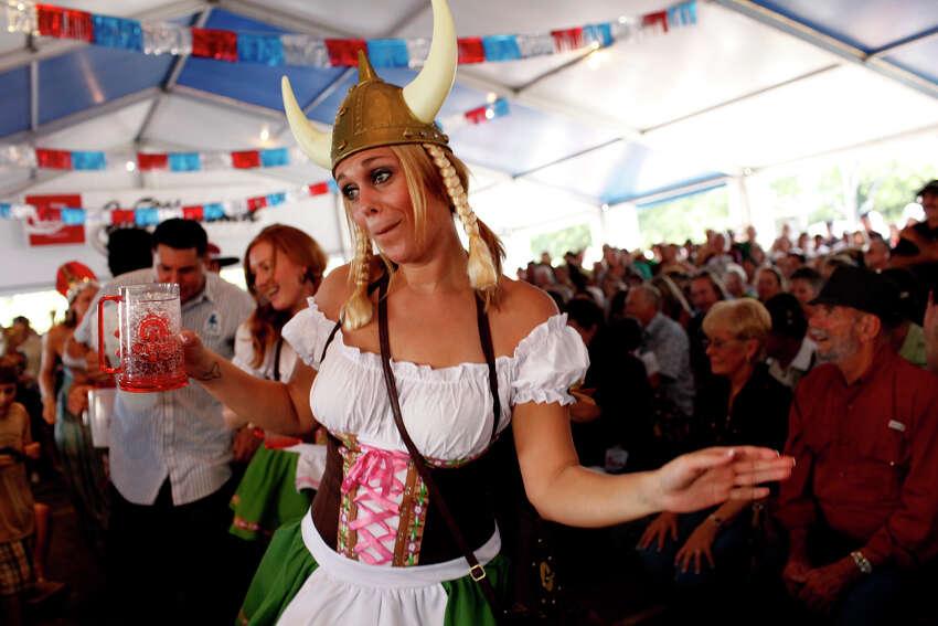 Cheyenne Hodges, of Austin, dances as the Alex Meixner Band plays during Wurstfest in New Braunfels on Saturday, Nov. 3, 2012.