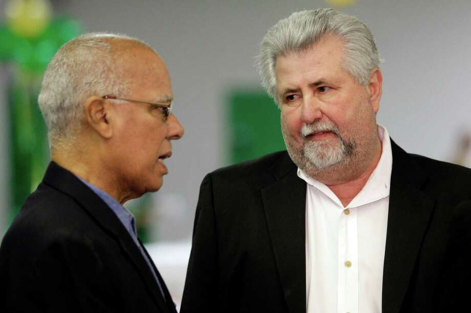HISD trustee Larry Marshall, left, talks with Pete Medford, owner of Fort Bend Mechanical, at the groundbreaking ceremony for renovations at Worthing High School on March 21. Photo: Melissa Phillip, Staff / © 2012 Houston Chronicle