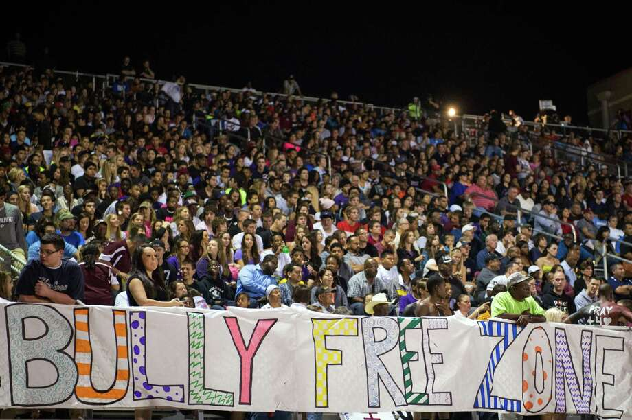 "A sign proclaims the stadium to be a ""Bully Free Zone"" during the second half of a high school football game between Manvel and Pearland at The Rig on Friday, Nov. 2, 2012, in Pearland. Photo: Smiley N. Pool, Houston Chronicle / © 2012  Houston Chronicle"
