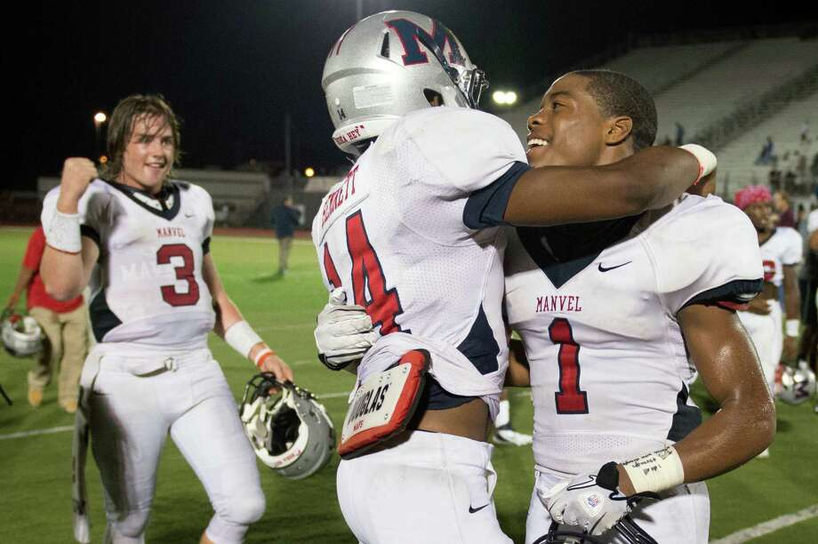 Manvel wide receiver Carlos Thompson (1) celebrates with wide receiver Austin Bennett (14) and quarterback Shane McCarley (3) after a victory over Pearland in a high school football game at The Rig on Friday, Nov. 2, 2012, in Pearland. Photo: Smiley N. Pool, Houston Chronicle / © 2012  Houston Chronicle