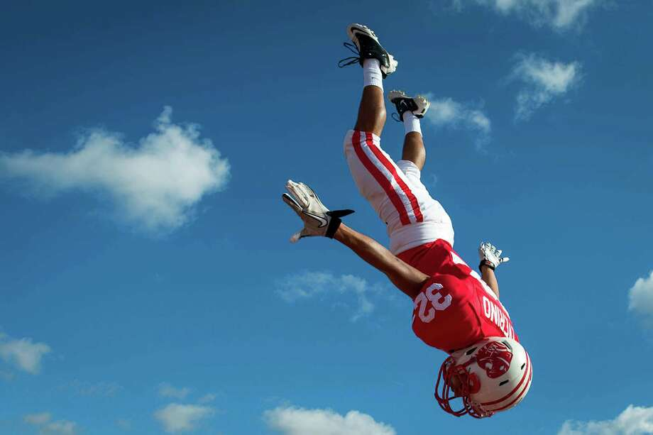 Katy 35, Cinco Ranch 21Katy defensive back Juan Yeverino is tossed high in the air over his teammates as they take the field before a high school football game against Cinco Ranch at Rhodes Stadium on Saturday, Nov. 3, 2012, in Katy. Photo: Smiley N. Pool, Houston Chronicle / © 2012  Houston Chronicle