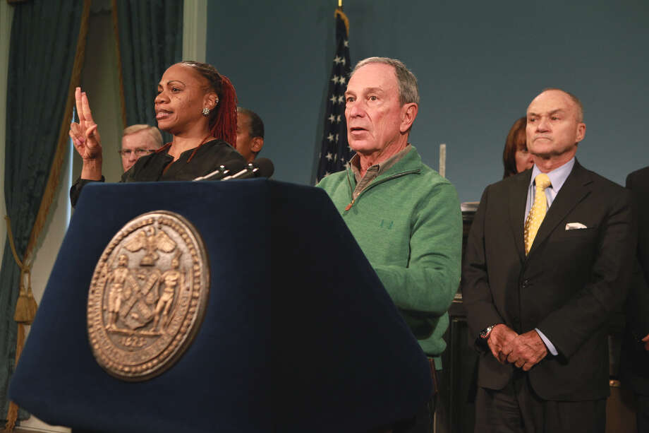 In this photo provided by New York City Mayor's Office, New York City Mayor Michael Bloomberg updates the media on the City's Superstorm Sandy recovery efforts, Friday, Nov. 2, 2012 in New York. Later that day Bloomberg Bloomberg cancelled the 2012 New York Marathon amid growing public pressure. Behind Bloomberg is NYC Police Commissioner Raymond Kelly. (AP Photo/NYC Mayor's Office, Kristin Artz) Photo: Kristin Artz