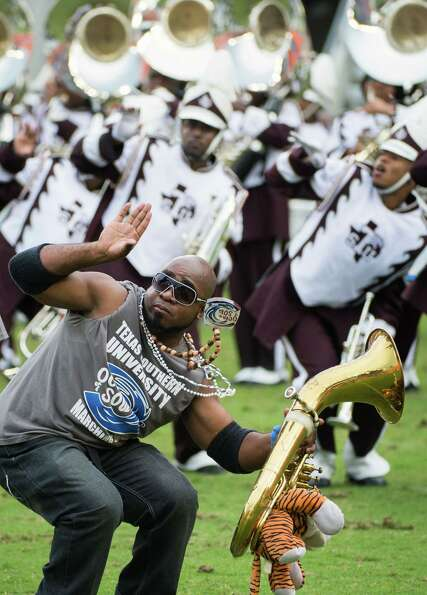 Texas Southern alumnus James I. Conley, Jr. performs with The Ocean of Soul marching band in the hal