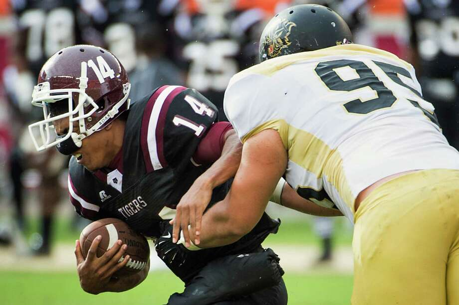 Texas Southern quarterback Rudy Johnson (14) is sacked by Arkansas-Pine Bluff defensive lineman Sean Robinson (95) during the first half of a college football game at BBVA Compass Stadium, Saturday, Nov. 3, 2012, in Houston. Photo: Smiley N. Pool, Houston Chronicle / © 2012  Houston Chronicle