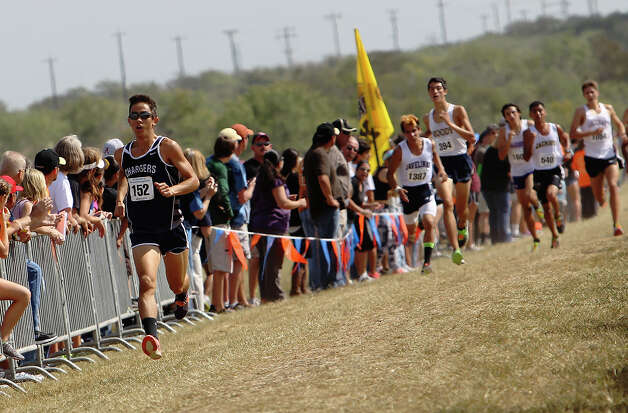 Boerne Champion's Andrew Tankersley pulls away from a pack to finish in second place with a time of 15:59 in the Division 4A boys race at the Region IV Cross Country Meet on Saturday, Nov. 3, 2012. Photo: Kin Man Hui, Express-News / © 2012 San Antonio Express-News