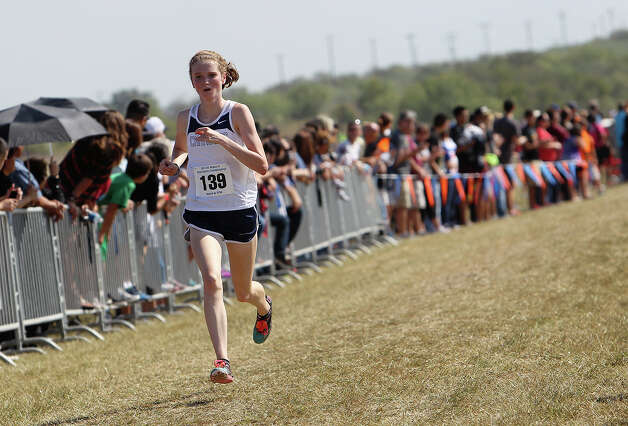Boerne Champion's Megan Briley heads to third place finish with a time of 18:38.1 in the Division 4A girls race at the Region IV Cross Country Meet on Saturday, Nov. 3, 2012. Photo: Kin Man Hui, Express-News / © 2012 San Antonio Express-News