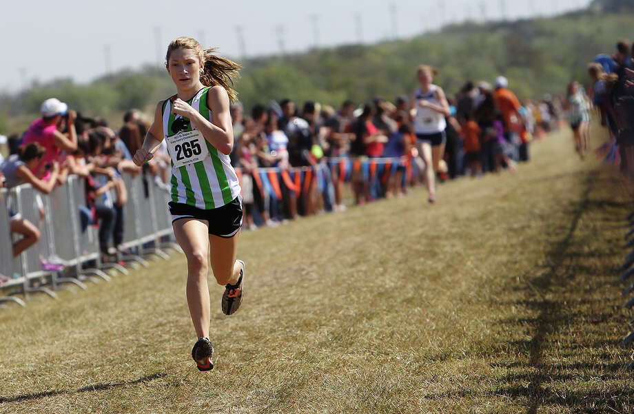 Cedar Park's Brittany Innis finishes in second place with a time of 18:30.6 in the Division 4A girls race at the Region IV Cross Country Meet on Saturday, Nov. 3, 2012. Photo: Kin Man Hui, Express-News / © 2012 San Antonio Express-News