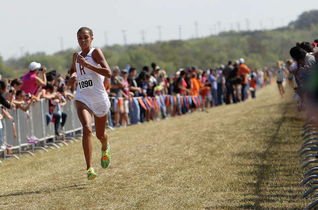 Leander Rouse's Madie Boreman strides to the finish line to take first place with a time of 18:17 in the Division 4A girls race at the Region IV Cross Country Meet on Saturday, Nov. 3, 2012. Photo: Kin Man Hui, Express-News / © 2012 San Antonio Express-News