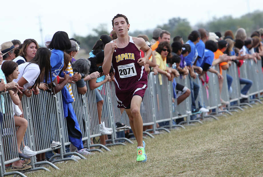 Zapata's Luis Garza finishes in third place with a time of 16:29.7 in the Division 3A boys race at the Region IV Cross Country Meet on Saturday, Nov. 3, 2012. Photo: Kin Man Hui, Express-News / © 2012 San Antonio Express-News