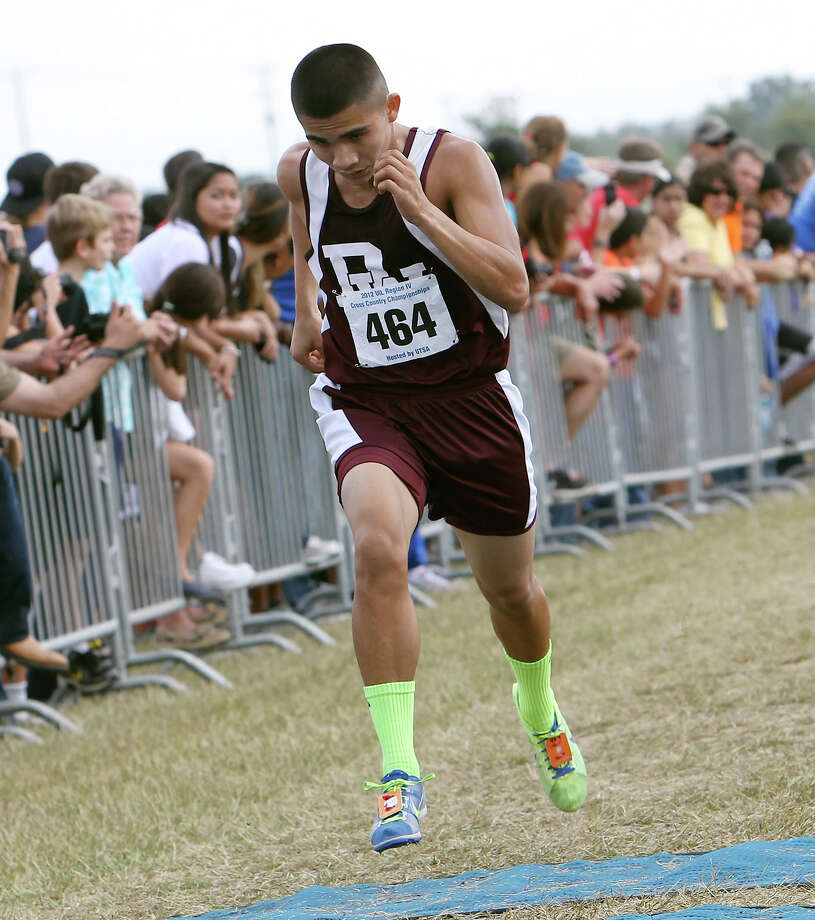 Devine's Joseph Espinosa takes second place with a time of 16:20.6 in the Division 3A boys race at the Region IV Cross Country Meet on Saturday, Nov. 3, 2012. Photo: Kin Man Hui, Express-News / © 2012 San Antonio Express-News